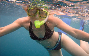 Girl snorkeling at Kiahuna Plantation